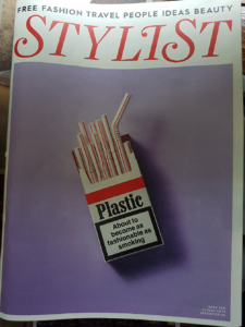 image of a magazine cover, depicting plastic straws in a cigarette box